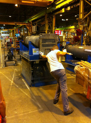 A Tarne operative building a heat exchanger in the Charmes factory.