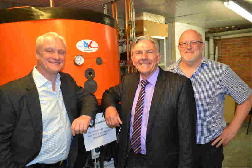 Graham Stuart, Ken Riley and Nigel Upson in front of the DK Heat Recovery water tank installed at Soanes Poultry