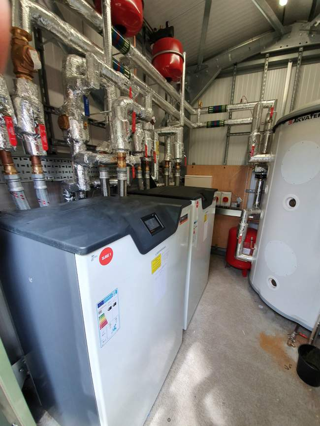 ground sopurce heat pump district heating borehole rhi energy saving renewables