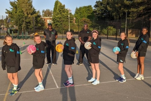 New players at Parkside Junior Netball Club sport their new JSW-branded hoodies in the company of their trainers