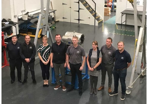 The move to new premises in Birkenhead has given SURE Solutions engineering and storage facilities, in addition to office space. From left, Rob Wharton, John Callan, Bryony Farr, Garry Shaw, Mark Parry, Joanne Kelly, Craig Costall and Craig Shaw