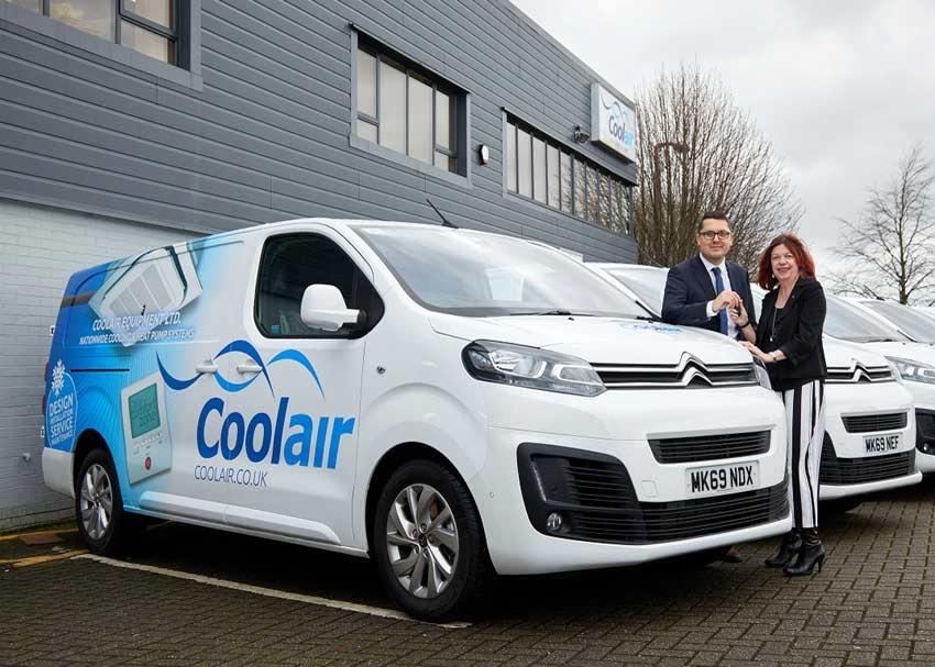 Citroen Regional Business Sales Manager James Walton handing keys to Coolair Equipment's Finance Director Helen Sharratt at the company's Manchester HQ