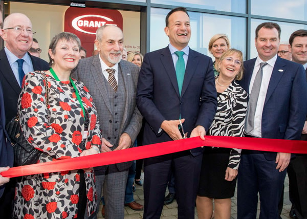 Irish Taoiseach Leo Varadkar cuts the ribbon watched by Stephen Grant, third from left,and Niall Fay, second from right