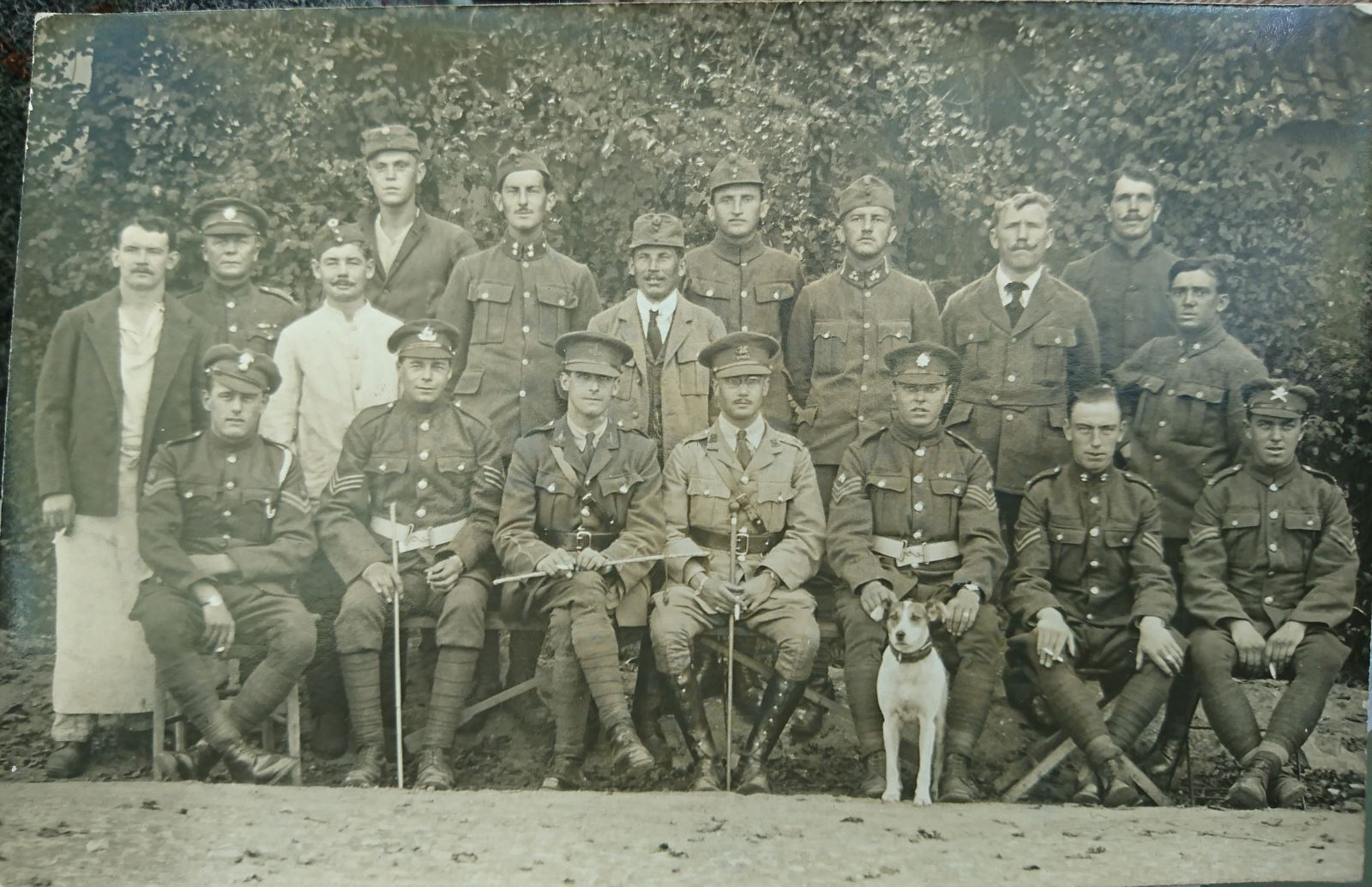 A Graves registration team... Those who locate., identify and exhumed Battlefield Graves in 1919/21. Capt SG Outwin, leader of this group seated centre right in lighter coloured uniform