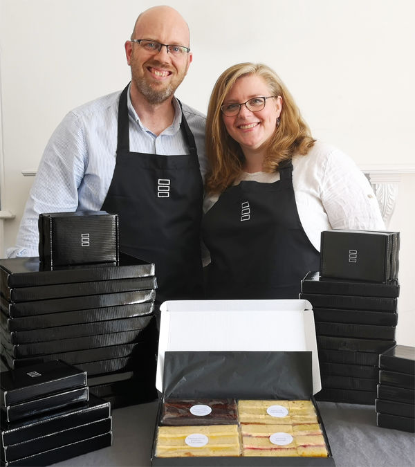 Phil and Christine Jensen headshot with cake boxes