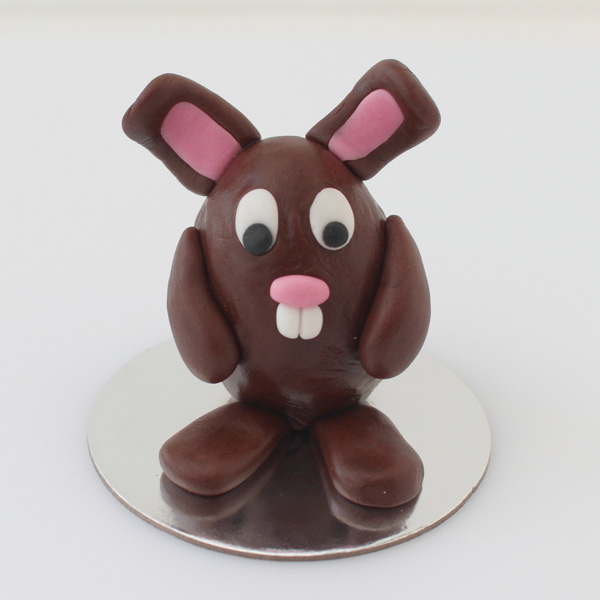 Fondant bunny with eyes, nose and teeth added