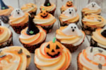 Halloween cupcakes with ghost, pumpkin and witches hat toppers