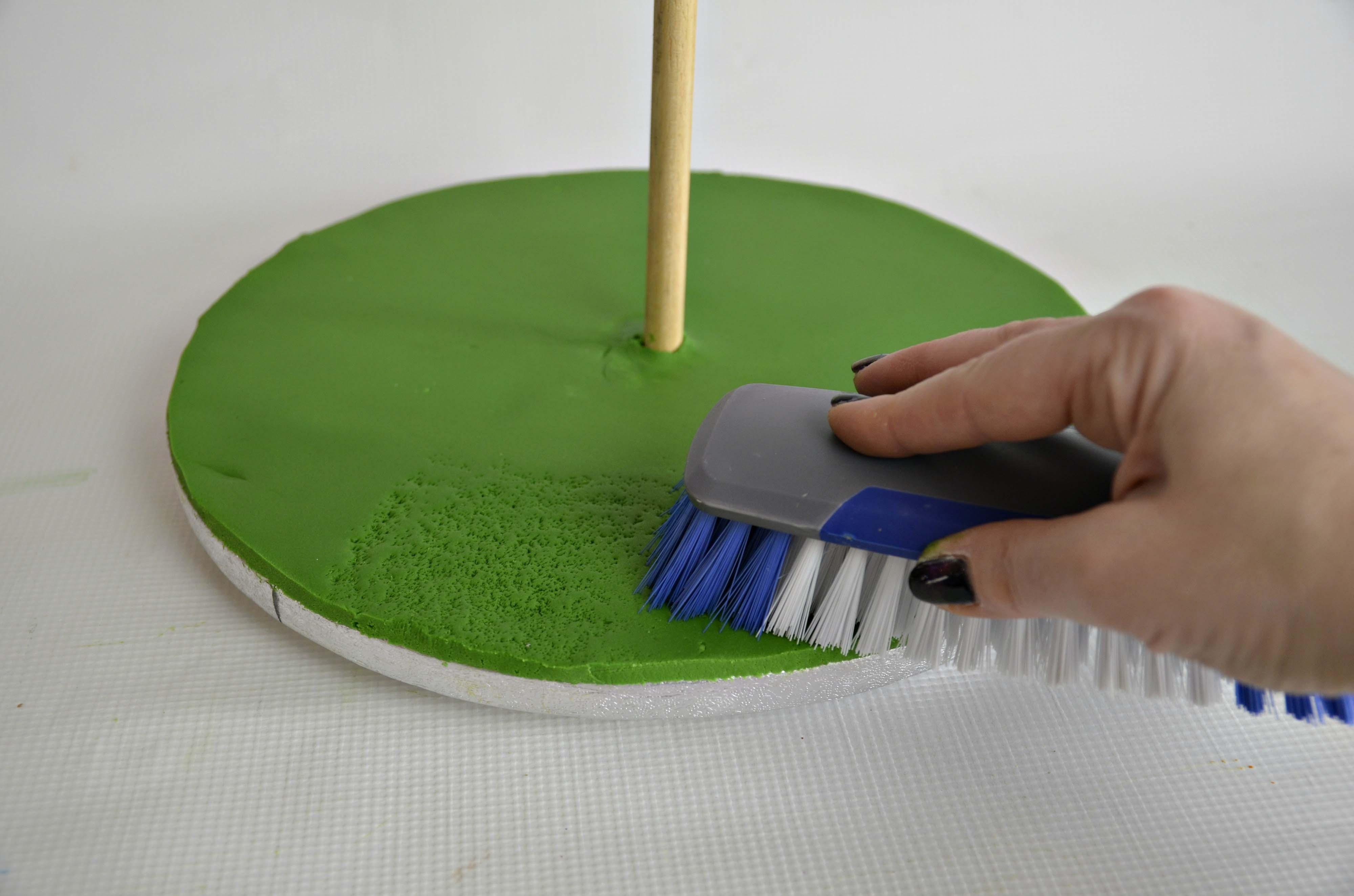 Green sugarpaste rolled onto cake drum