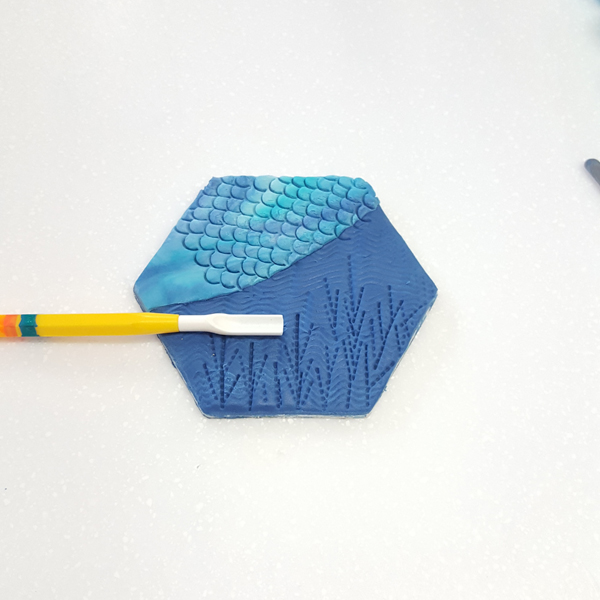 Scallop and comb tool mermaid tail and fish scales