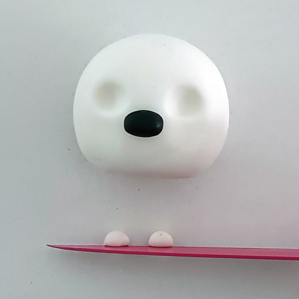 Fondant snowman with nose and eyes being created