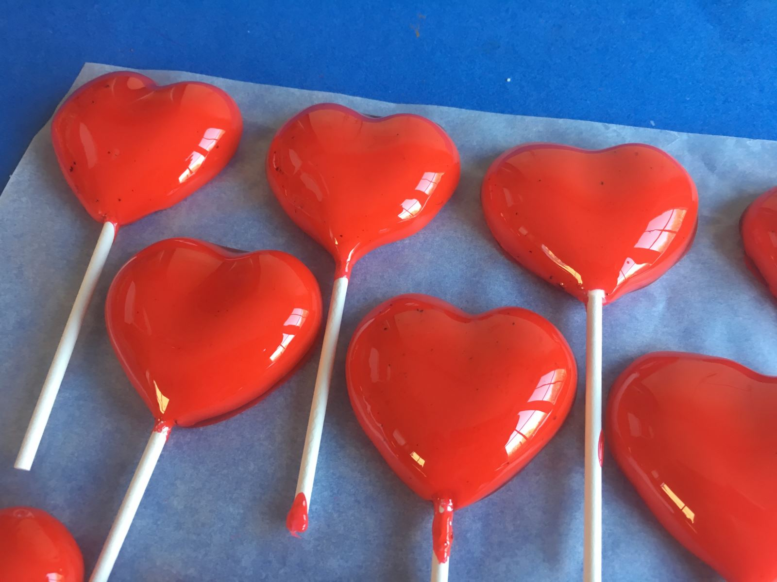5 Place the hearts onto greaseproof paper to harden.