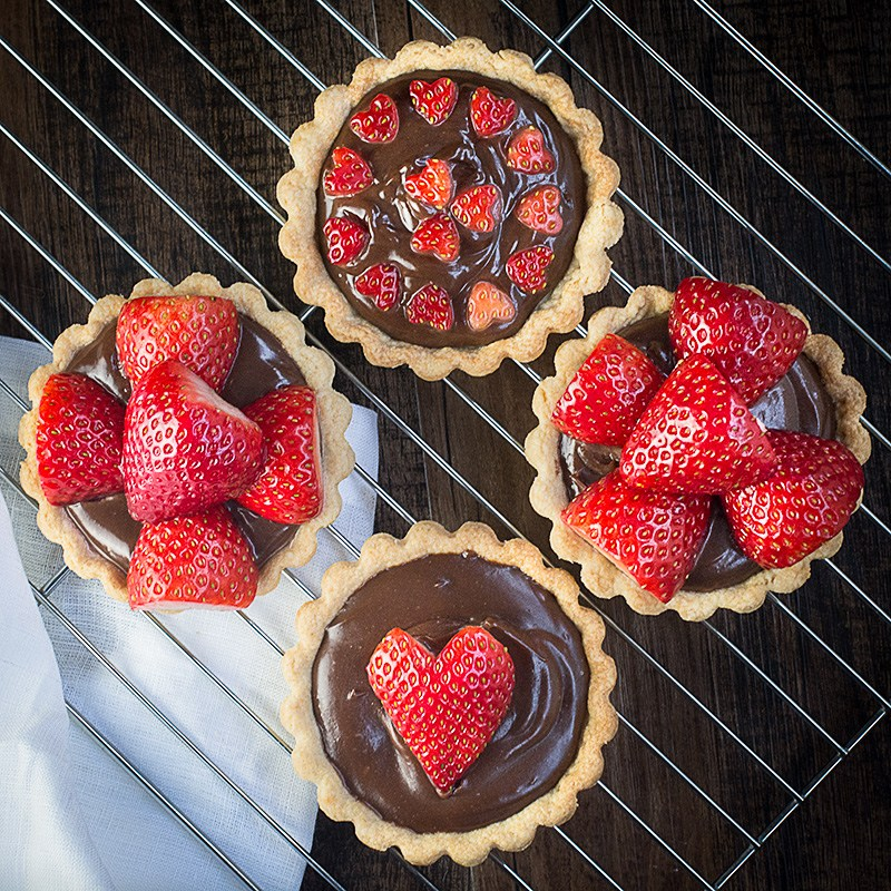 Charlotte's Strawberry and Champagne Truffle Tarts, decorated with heart-shaped strawberries