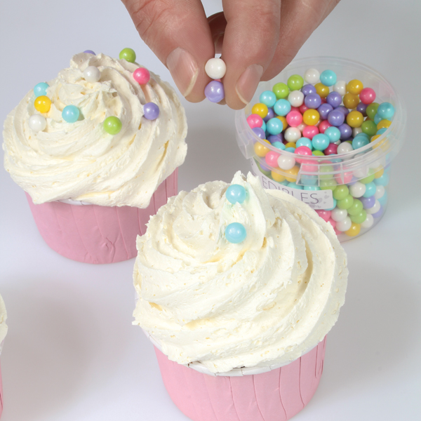 Rainbow cupcakes with Sugar Pearls sprinkled on piped buttercream