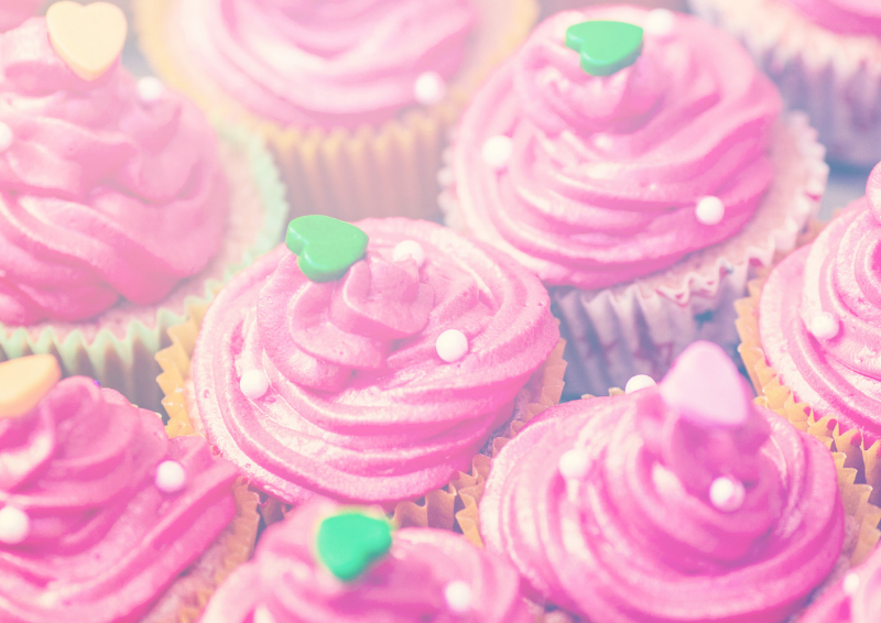 Cupcakes with pink frosting and green love hearts