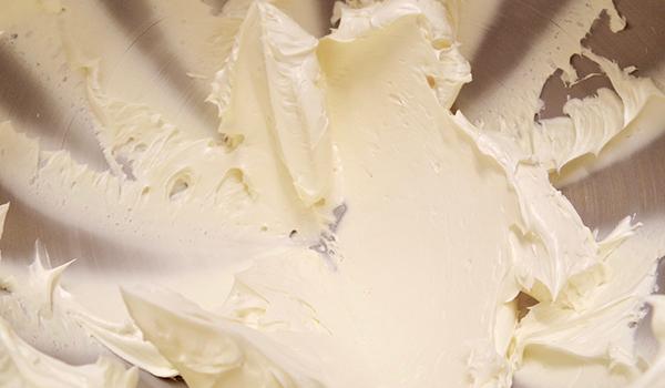 Butter in a mixer bowl
