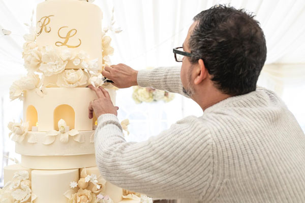 Victor Diaz creating tiered cake