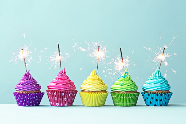 Colourful cupcakes with sparklers