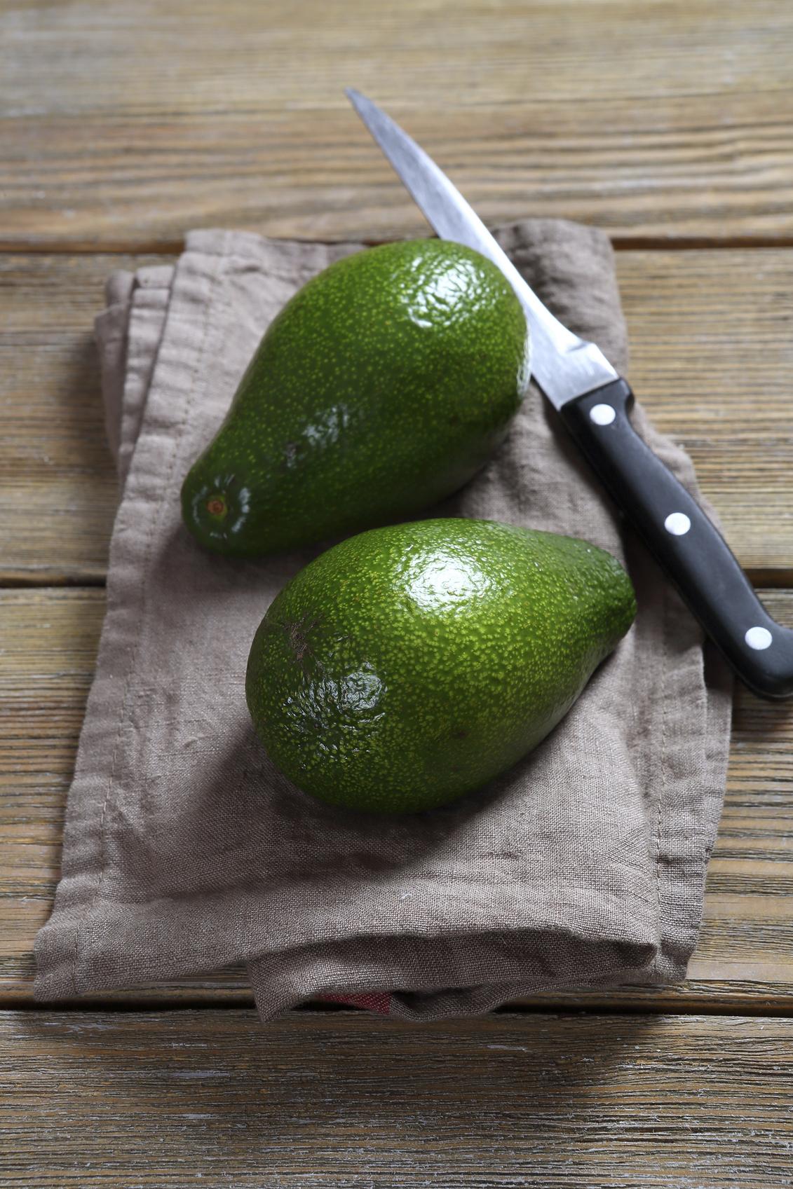 Two fresh avocado on a napkin, vegetable