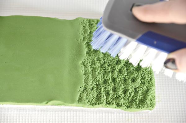 texturing grass using a plastic bristle