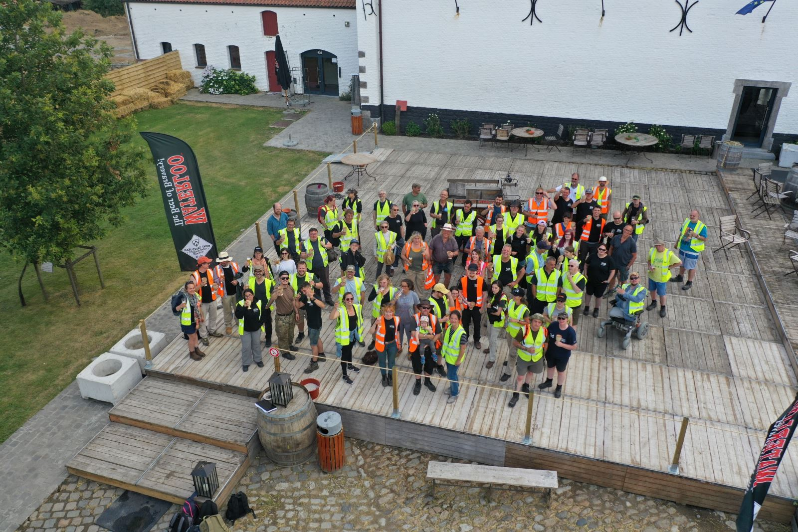 An aerial shot of the full Waterloo Uncovered 2019 team in the courtyard of Mont-Saint-Jean farm after a hard day of work. Photo by Matt Weston.