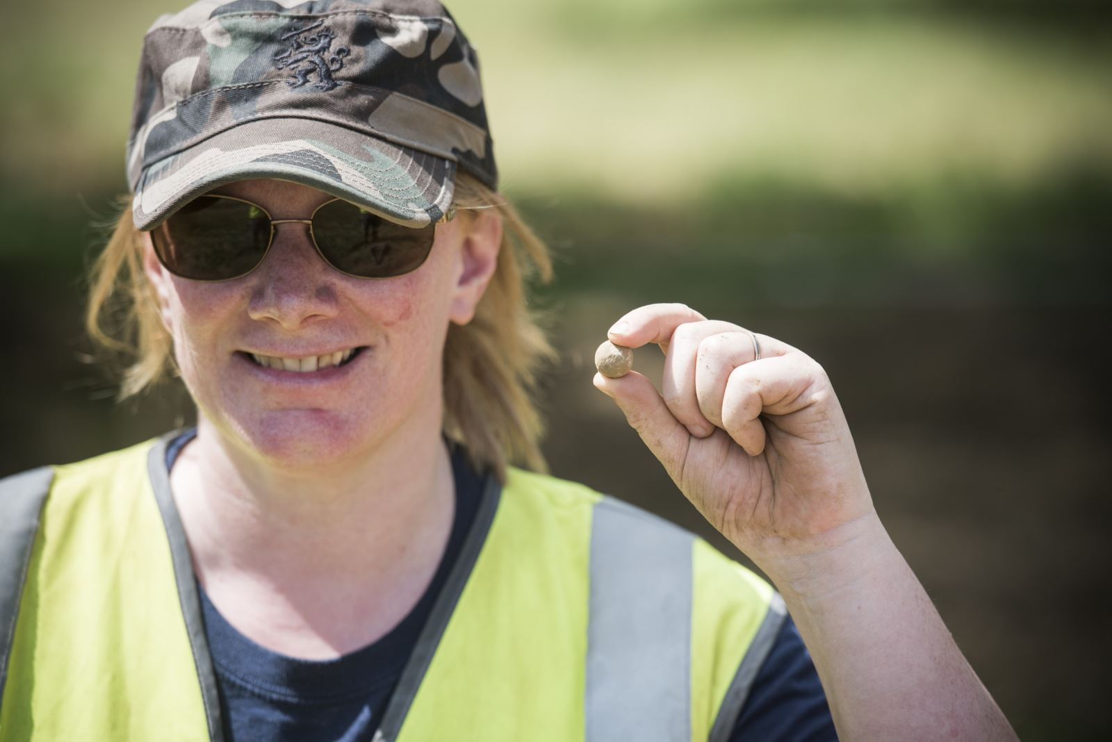 Waterloo Uncovered volunteer holds one of the musket balls found at Mont-Saint-Jean. Photo by Chris van Houts.