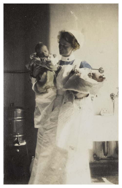 Mary-Cunningham,-nurse,-holding-two-babies-at-Edinburgh-Royal-Maternity-Hospital-87623.png