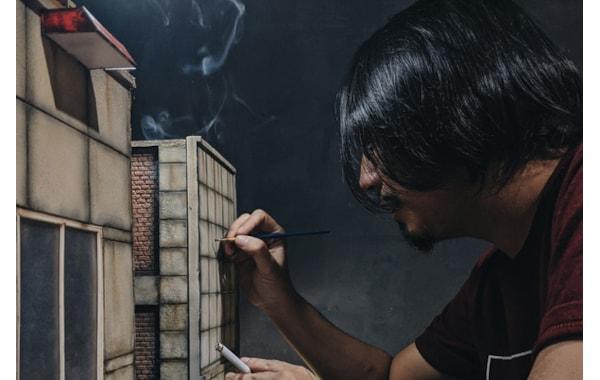 Max Aditya working on miniature building