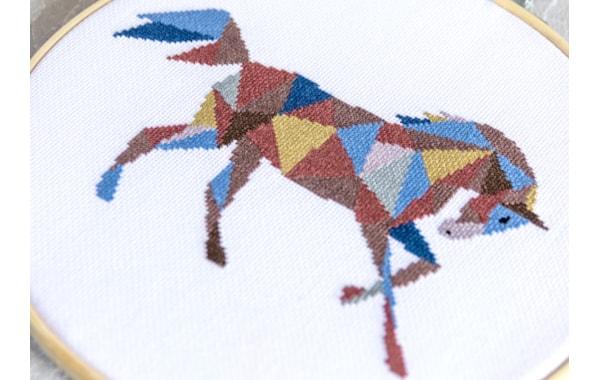 Velvet Pony geometric horse cross stitch design in a hoop