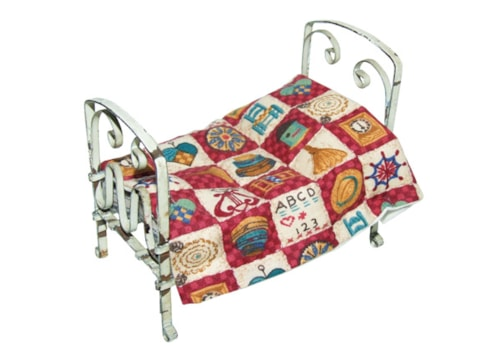 patchwork quilt on a miniature bed