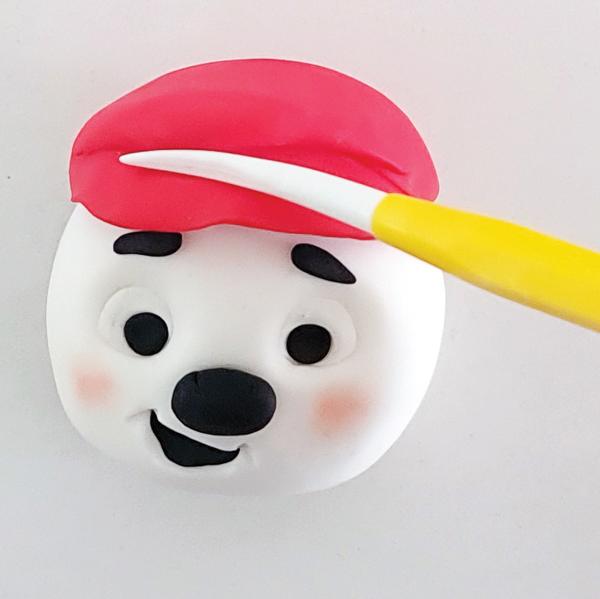 Red hat on fondant snowman.