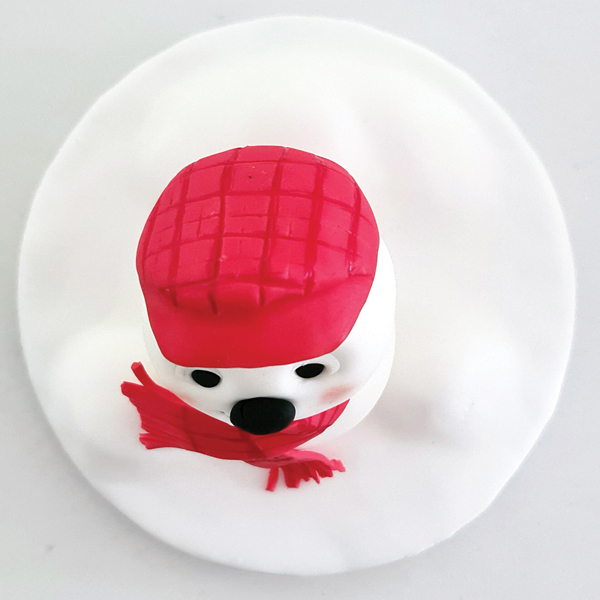 Fondant snowman head, placed on top of the body.