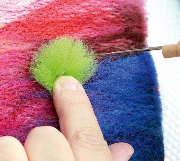Making a third bush from wool top fibres and stabbing it in