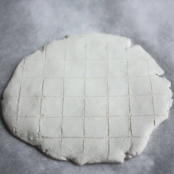 Lightly marked grid on clay sheet