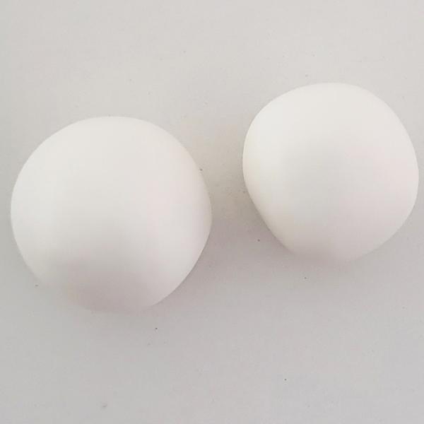 Two white sugarpaste balls for fondant snowman body and head