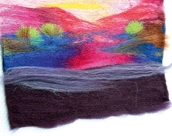 Pulling wool top fibre strands across