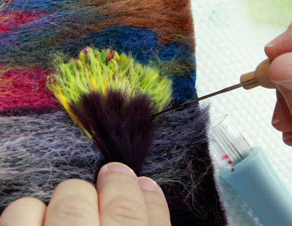 Making a smaller fan of Aubergine colour fibres and placing over bush