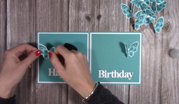 Adhere sentiment to butterfly accordion card