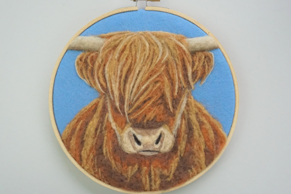 Dani Ives' Highland Cow finished embroidery hoop for display