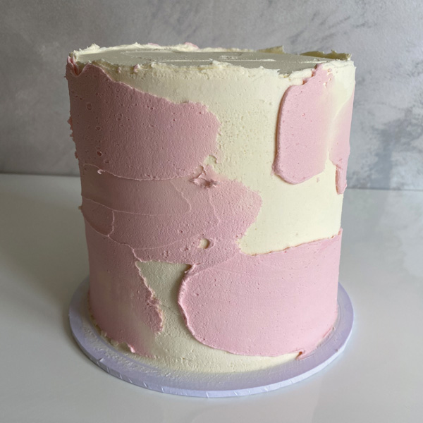 creating textured watercolour effect with pink buttercream