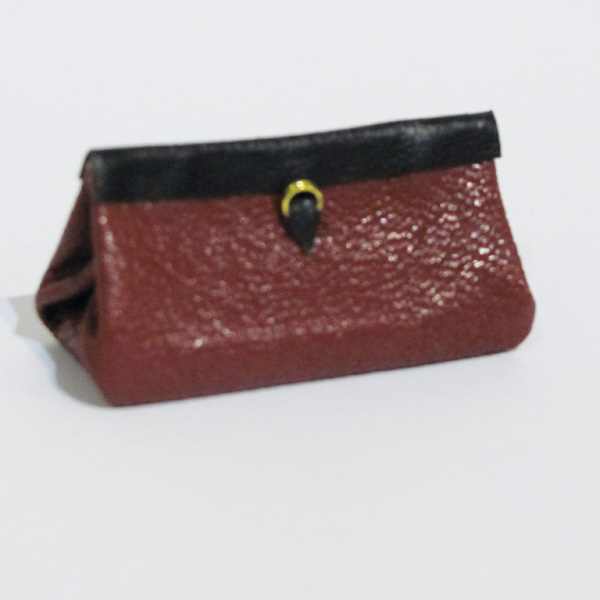 Miniature leather travel bag without handle