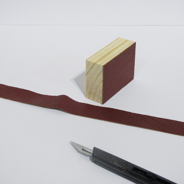 Cut leather strips for miniature suitcase