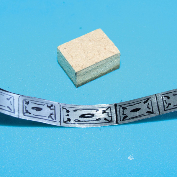 Metal strip with design