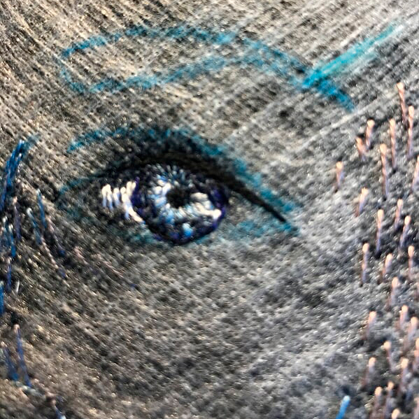 Hand embroidered eyes and skin in progress