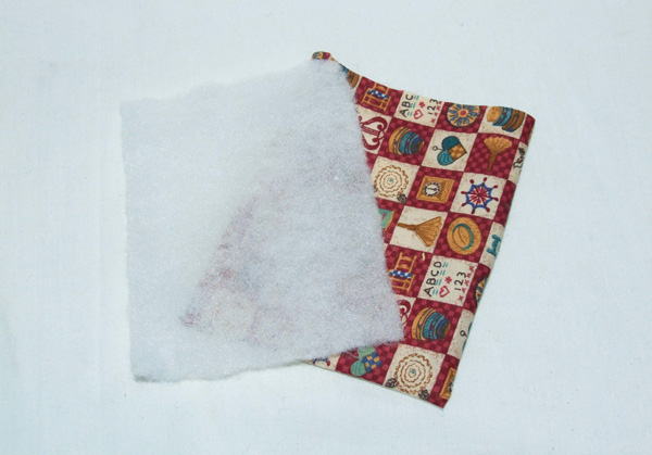 wadding material and patterned fabric pieces
