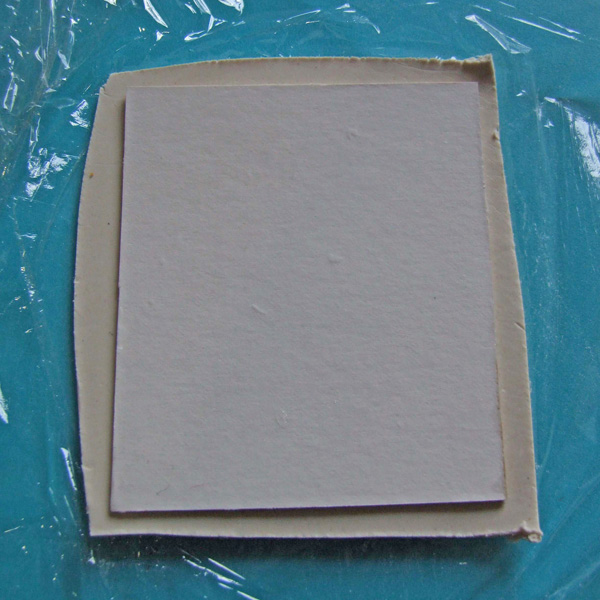 Card laid on paperclay