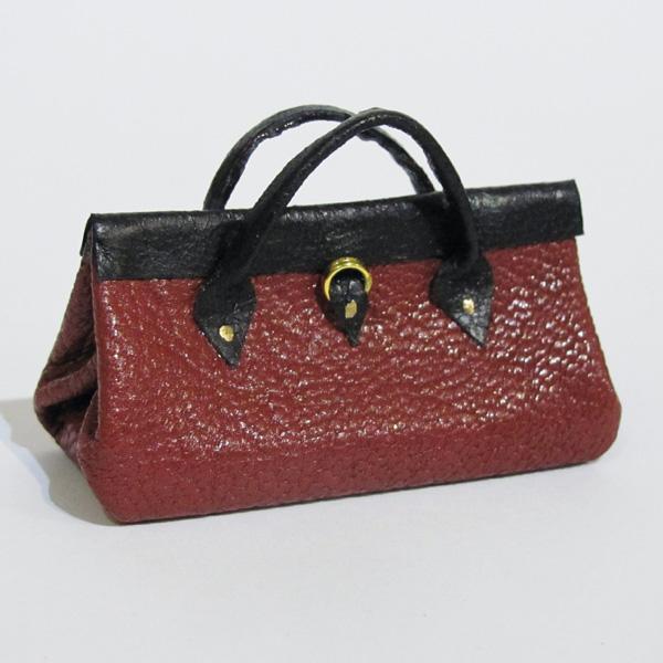 finished miniature leather bag