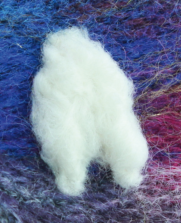 Creating two thin sheep legs from wool top fibres