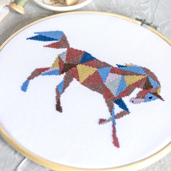 geometric horse cross stitch design in hoop by Velvet Pony