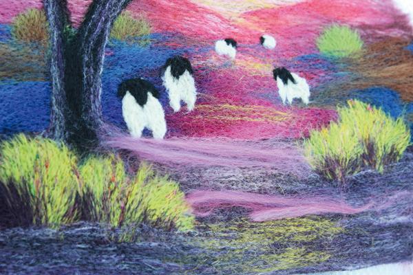Colourful needle felted hillside scene