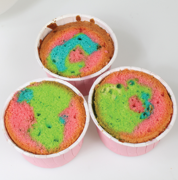 Rainbow cupcakes out of the oven